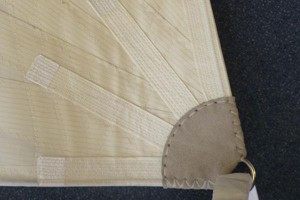 clew ring webbed on with leather chaff protection and flattening eyelet